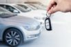 Man's hand holding car key.Automobile rent or leasing concept.